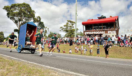 The crowd cheers on a team in the Australia Day dunny races at the Ettamogah Pub.